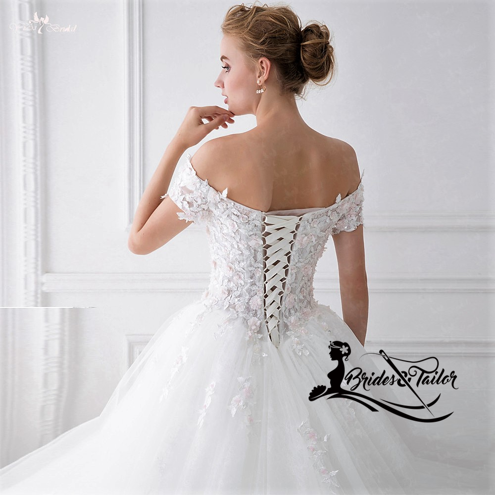 Off shoulder wedding dress customized by Brides & Tailor